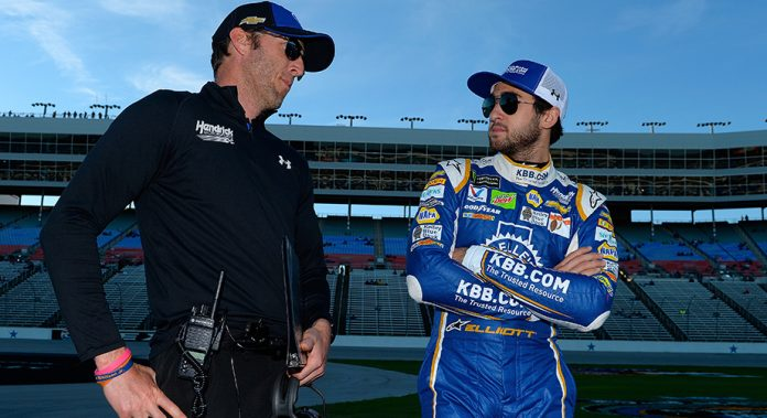 Chase Elliott and crew chief Alan Gustafson talk on the grid during qualifying for the Monster Energy NASCAR Cup Series AAA Texas 500