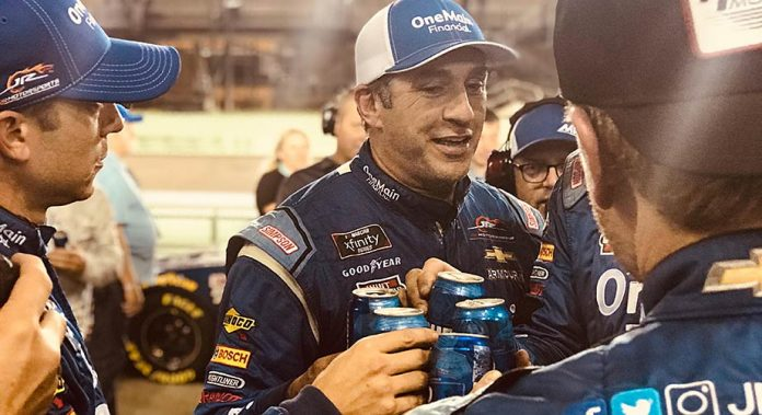 Elliott Sadler shares a post-race drink with his JR Motorsports team at Homestead-Miami Speedway.
