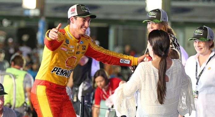 Joey Logano greets his family in Victory Lane