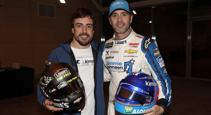 Jimmie Johnson and Fernando Alonso pose for a photo in Bahrain.