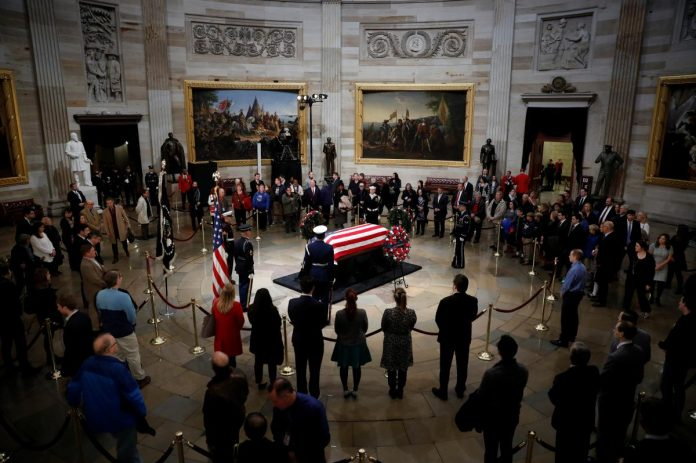 Americans pay respects to late President Bush at U.S. Capitol