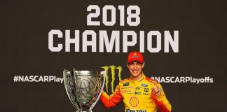 Joey Logano stands with the Monster Energy NASCAR Cup Series Championship trophy