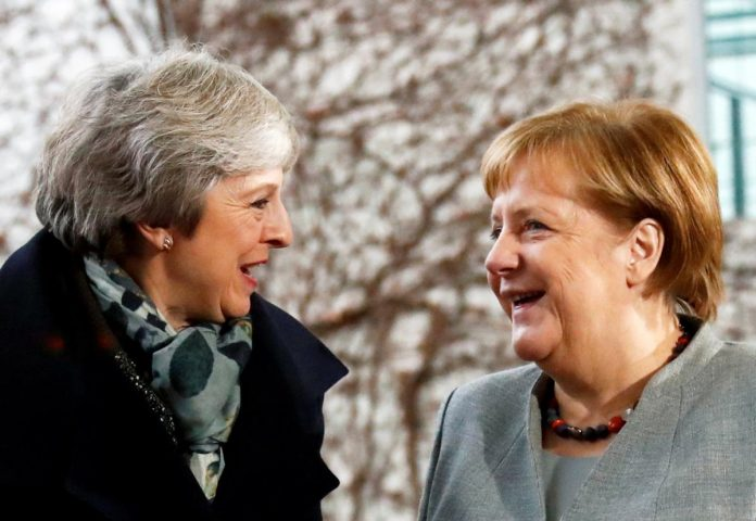 After May asks for help, Germany's Merkel says no more Brexit negotiations
