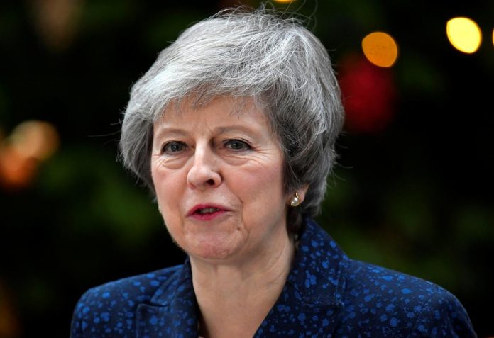 UK PM May's lawmakers trigger confidence vote in her leadership