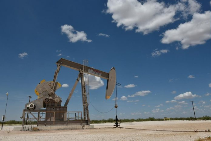 Oil prices sink to lowest in a year as stock markets fall