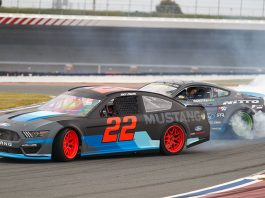 Joey Logano drifts in the new Ford Mustang