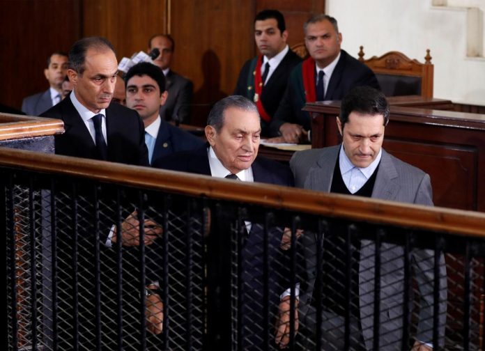 Deposed Egyptian presidents come face to face in court