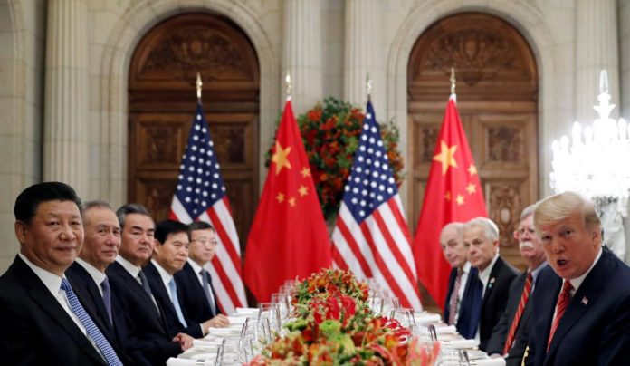 China says direct trade talks with U.S. in January, pledges more opening