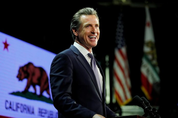 California's new governor takes aim at Trump as he takes office