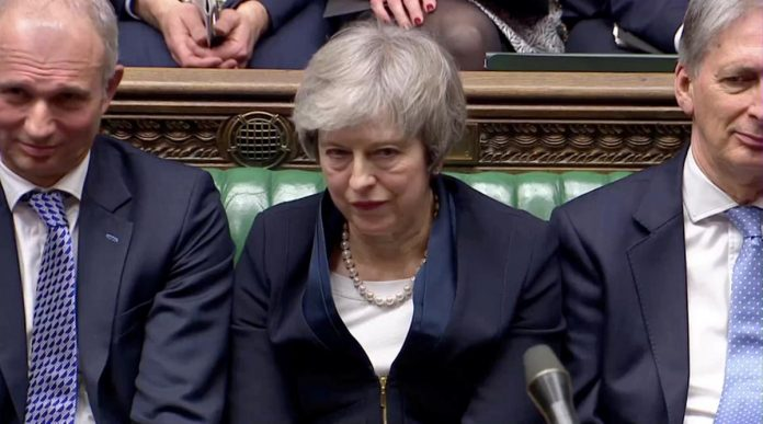 UK PM May faces confidence vote as Brexit goes down to the line