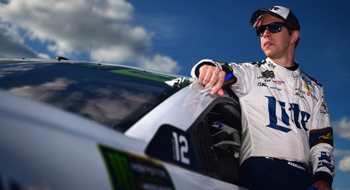 Brad Keselowski stands next to the No. 2 Ford before qualifying at Talladega.