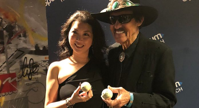 Jeanette Lee and Richard Petty exchange cue balls at a San Francisco appearance.