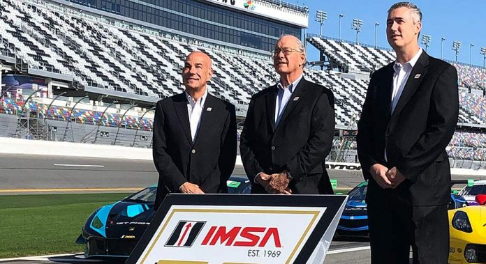 From left, IMSA President Scott Atherton, IMSA Chairman, Jim France and IMSA CEO Ed Bennett on pit road at Daytona International Speedway.