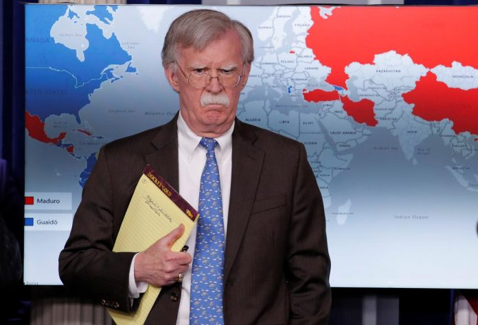 Bolton's notes raise questions on troops as pressure builds in Venezuela