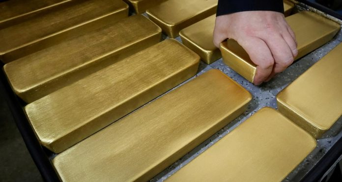 Gold hits eight-month high, stocks mixed amid trade caution, results