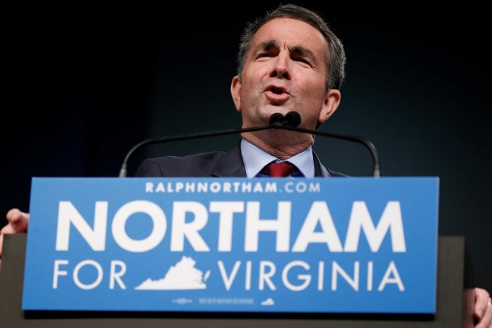 Virginia governor resists mounting pressure to resign