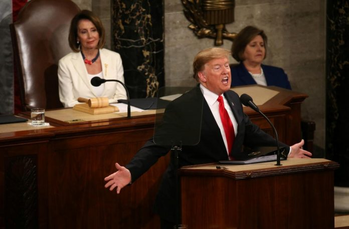 Trump vows to build border wall, warns Democrats against investigations