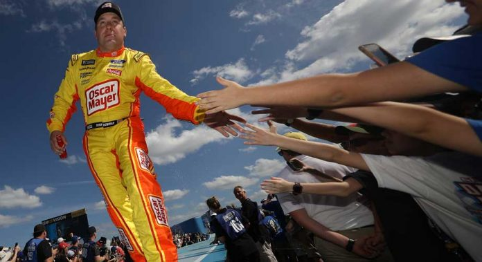 Ryan Newman gives high-fives to fans as he walks out during driver introductions.