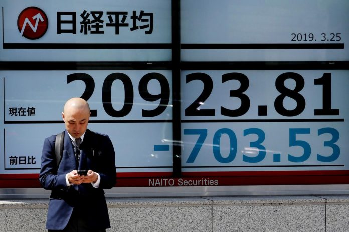 Asian stocks inch higher on hopes of progress in U.S.-China talks