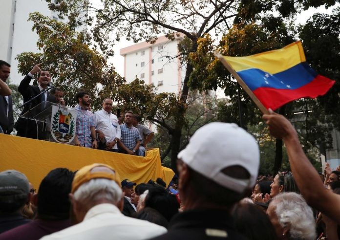 White House warns Russia over troops in Venezuela, threatens sanctions