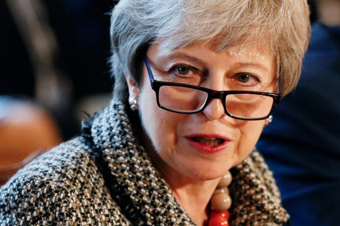 Britain's May calls in ministers to find way out of Brexit maelstrom