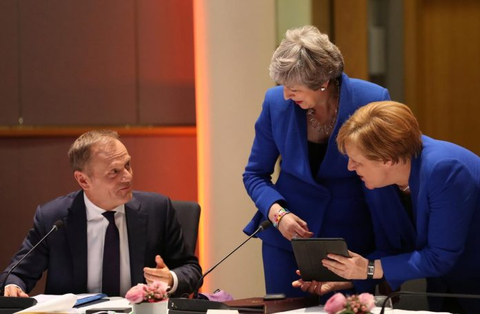 EU gives May till October for Brexit, seeking clarity