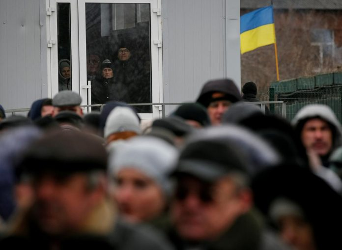 Russia eases path to citizenship for east Ukraine residents