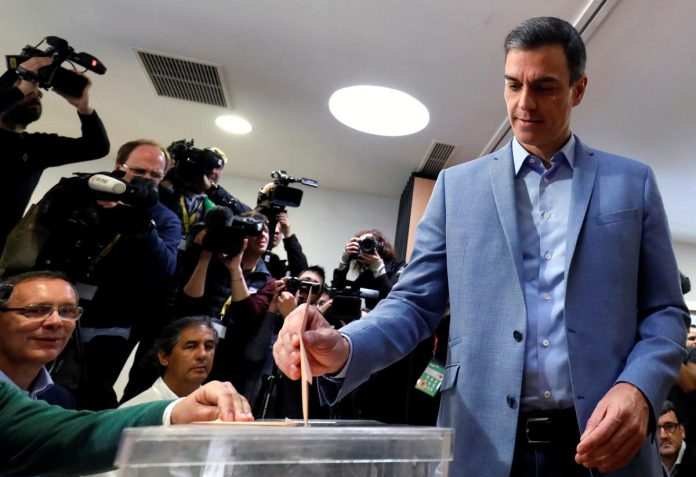 Spain votes in wide-open election after tense campaign