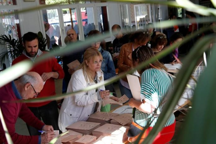 Spaniards flock to polls in wide-open election after tense campaign