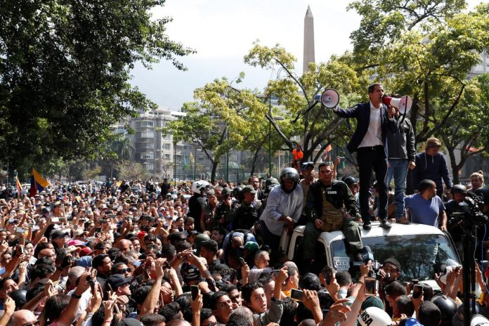 Venezuela's Guaido calls for uprising but military remains loyal to Maduro for now