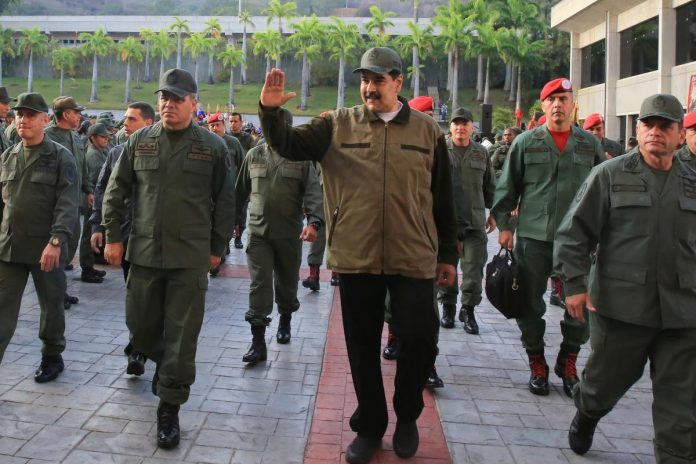 Venezuela's Maduro seeks to display military loyalty in political crisis