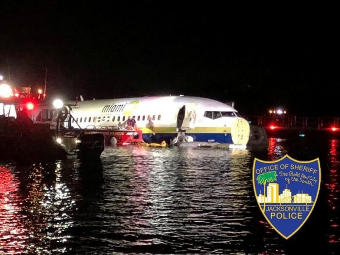 Boeing 737 slides off runway into Florida river, 21 hurt