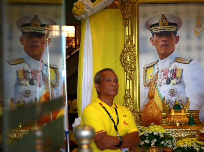 Crowds gather for coronation procession of Thai king