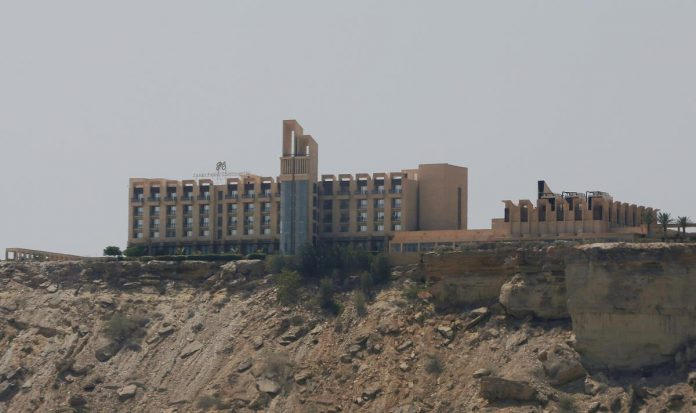 Pakistani forces comb hotel a day after raid kills at least five