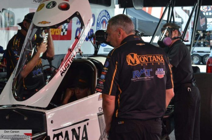 GREEN ADJUSTING TO TUNING PROCK'S TOP FUEL DRAGSTER AT JFR