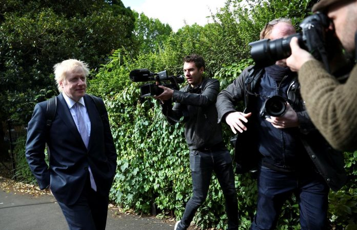 UK PM candidate Johnson to face court over Brexit claims