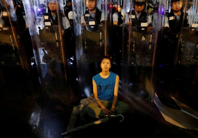 Tens of thousands of protesters force delay in Hong Kong extradition bill debate