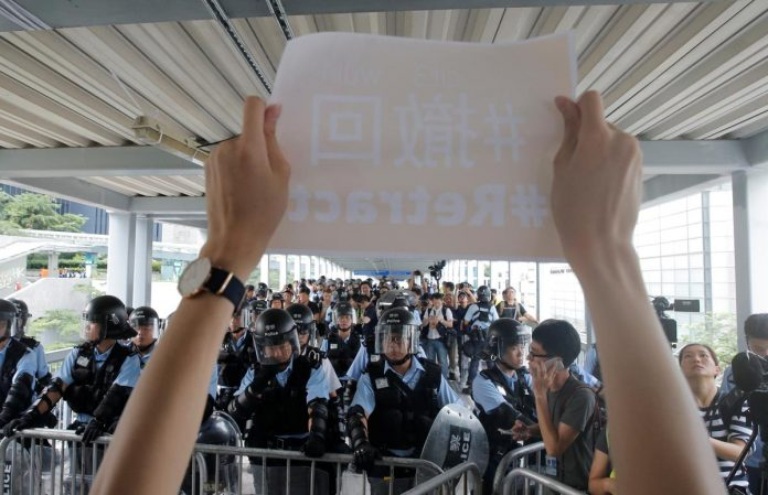 Thousands of Hong Kong protesters gather, government offices shut after violent protests