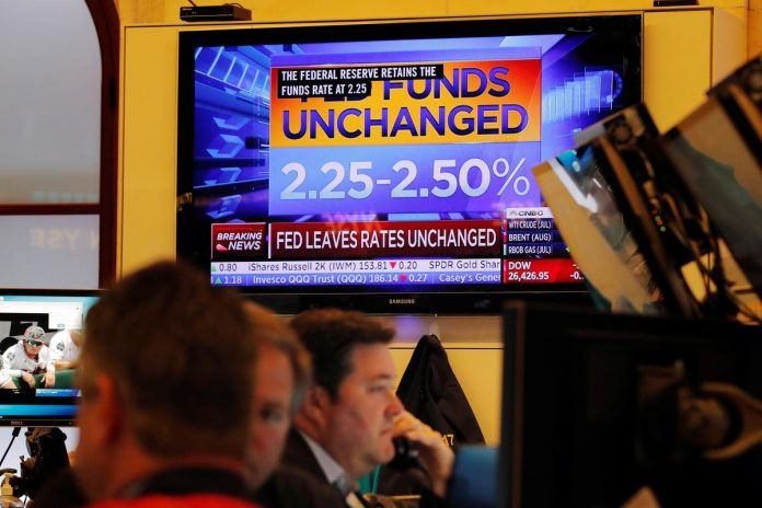 Stocks climb as Fed soothes Wall Street's trade fears