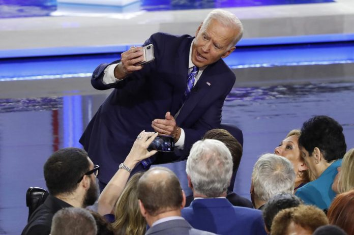 Biden defends civil-rights record after U.S. debate attack