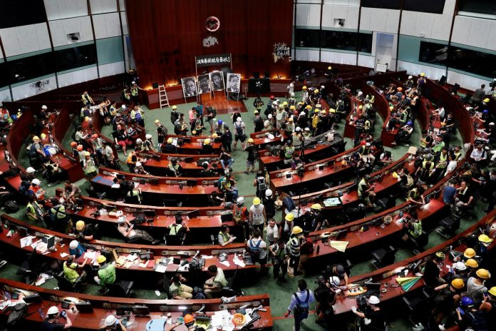 Hong Kong protesters smash up legislature in direct challenge to China