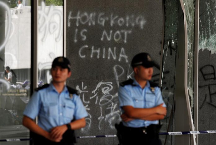 China denounces violent Hong Kong protests as 'undisguised challenge' to its rule