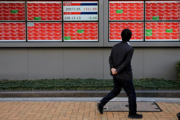 Asian shares hold near two-month highs before U.S. payrolls test