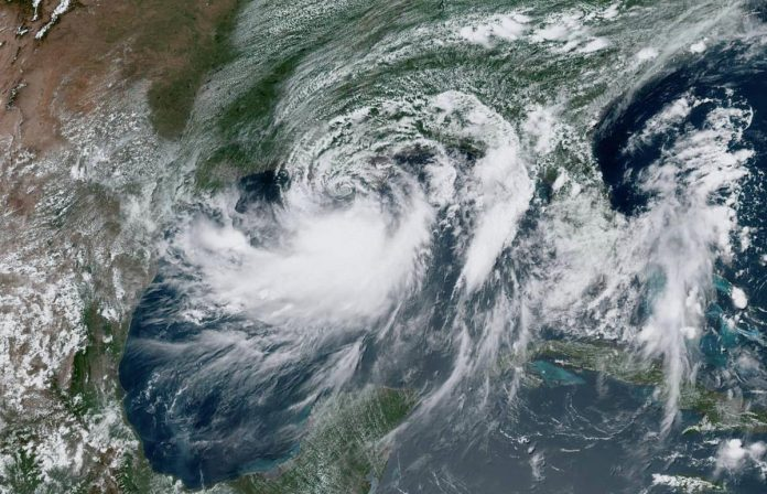 Barry churns off Louisiana, New Orleans storm surge lower than feared