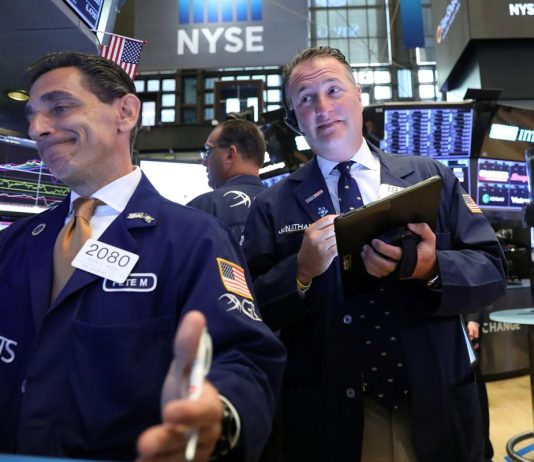 Global stocks fall on trade, earnings caution; oil drops