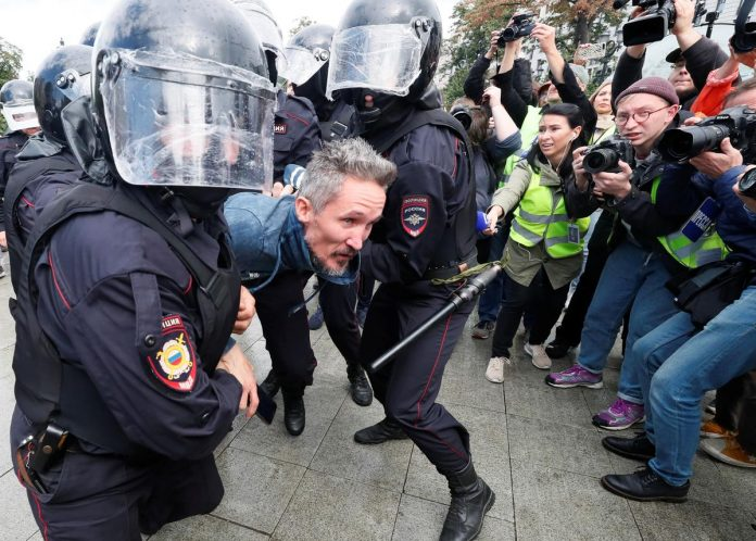 Russian police detain nearly 100 opposition protesters in Moscow