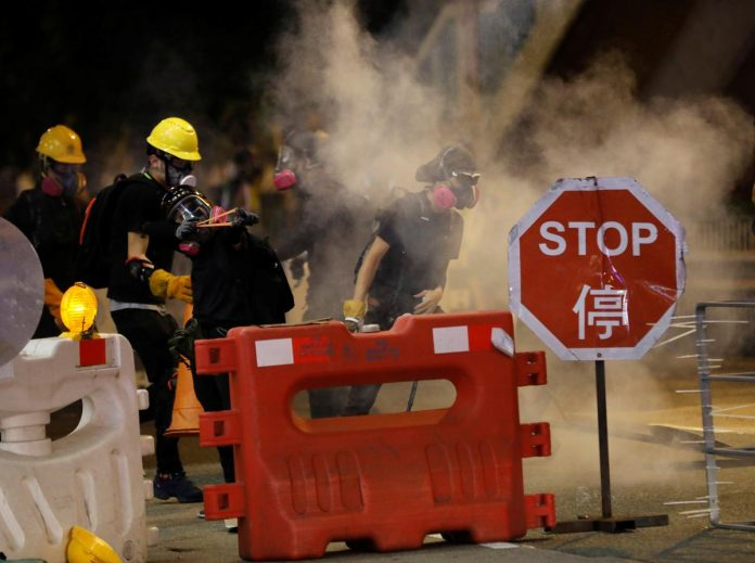 Hong Kong government: protests are pushing city to 'extremely dangerous edge'