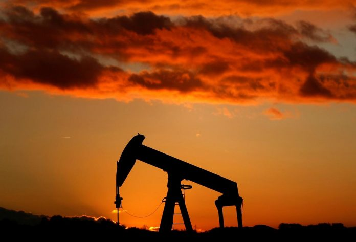 Oil dives 4% to seven-month low on surprise U.S. stock build, trade war