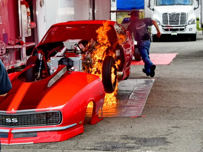TS RACER TREES HAS ENGINE CATCH FIRE IN WSOPM PITS