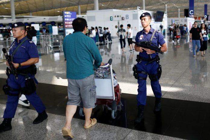 Hong Kong airport reopens, official China newspaper urges end to violence